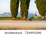 running mother with child in... | Shutterstock . vector #724491340