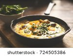 omelette with vegetables in old ... | Shutterstock . vector #724505386
