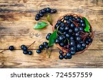 bunches of chokeberry in wicker ... | Shutterstock . vector #724557559