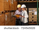 female manager and warehouse... | Shutterstock . vector #724565020