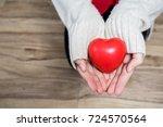 beautiful young woman wearing a ... | Shutterstock . vector #724570564