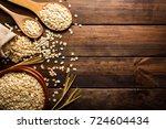 oat flakes  uncooked oats in... | Shutterstock . vector #724604434
