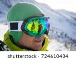 reflected in the glasses... | Shutterstock . vector #724610434