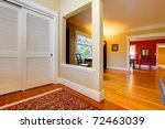Nice large open hallway and living room with red wall - stock photo