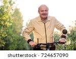 senior caucasian man on cycle... | Shutterstock . vector #724657090