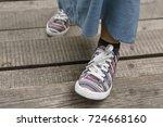 girl in sneakers walking on a... | Shutterstock . vector #724668160