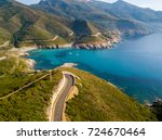 Aerial view of the coast of Corsica, winding roads and coves with crystalline sea. Cap Corse Peninsula, Corsica. Coastline. Anse d