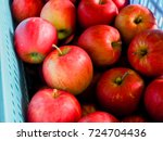 red apples are placed in a blue ... | Shutterstock . vector #724704436