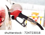 close up of gas gun with car | Shutterstock . vector #724723018