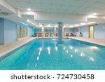indoor swimming pool in hotel... | Shutterstock . vector #724730458