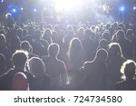 rear view of crowd with arms... | Shutterstock . vector #724734580