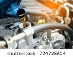 refueling and pouring oil into... | Shutterstock . vector #724738654