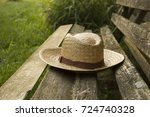 A Forgotten Straw Hat On An Ol...