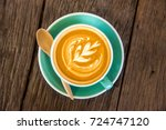 cup of coffee on old wooden... | Shutterstock . vector #724747120