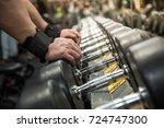 hand holding dumbbell in the... | Shutterstock . vector #724747300