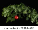 Red Christmas Ball On A Spruce...