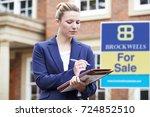 female realtor standing outside ... | Shutterstock . vector #724852510