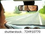 woman looking in rear view...   Shutterstock . vector #724910770