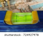 Small photo of Part of spirit level. Horizontally aligned bubble mark