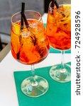 aperol spritz cocktail in glass | Shutterstock . vector #724928596