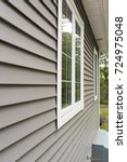 vinyl siding and windows on... | Shutterstock . vector #724975048