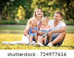 happy family blowing soap... | Shutterstock . vector #724977616