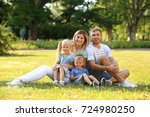 happy family in park on sunny... | Shutterstock . vector #724980250