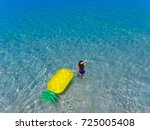 top aerial view of a woman with ... | Shutterstock . vector #725005408