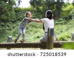 mother and daughter playing in... | Shutterstock . vector #725018539