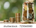 stack of coins and jar with... | Shutterstock . vector #725060080