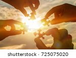 collaborate four hands trying... | Shutterstock . vector #725075020
