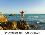 Small photo of Young woman meets sea on the shore the Black Sea in Crimea, she is looking to the horizon. People freedom style. A girl heaved up hands. On a background the sea waves summer. Vacation.
