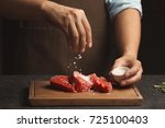 chef cooking meat on table | Shutterstock . vector #725100403