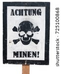 Small photo of Antique wooden sign, isolated against a white background, in German language and with a skull and crossbones warning of landmines.