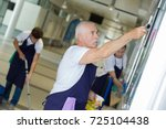 professional cleaners team...   Shutterstock . vector #725104438