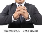 businessman in a suit praying | Shutterstock . vector #725110780