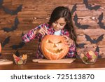 Cute Little Girl Is Carving A...