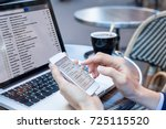 business person reading emails... | Shutterstock . vector #725115520
