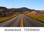 long straight road ahead in Badlands National Park, South Dakota,