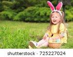 cute little girl with basket of ... | Shutterstock . vector #725227024