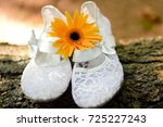 White Lace Shoes Along With An...