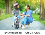 mother teaching her daughter to ... | Shutterstock . vector #725247208