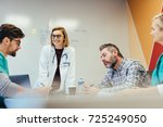 four physicians in meeting at...   Shutterstock . vector #725249050