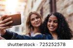girls clicking a selfie using