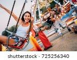 two friends at amusement park.... | Shutterstock . vector #725256340