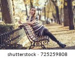 young blonde woman sitting on a ... | Shutterstock . vector #725259808