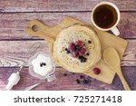 breakfast with pancakes and tea.... | Shutterstock . vector #725271418