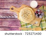 stack of fresh russian pancakes.... | Shutterstock . vector #725271430