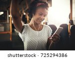 smiling young african woman... | Shutterstock . vector #725294386