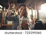 young woman wearing earphones... | Shutterstock . vector #725299360